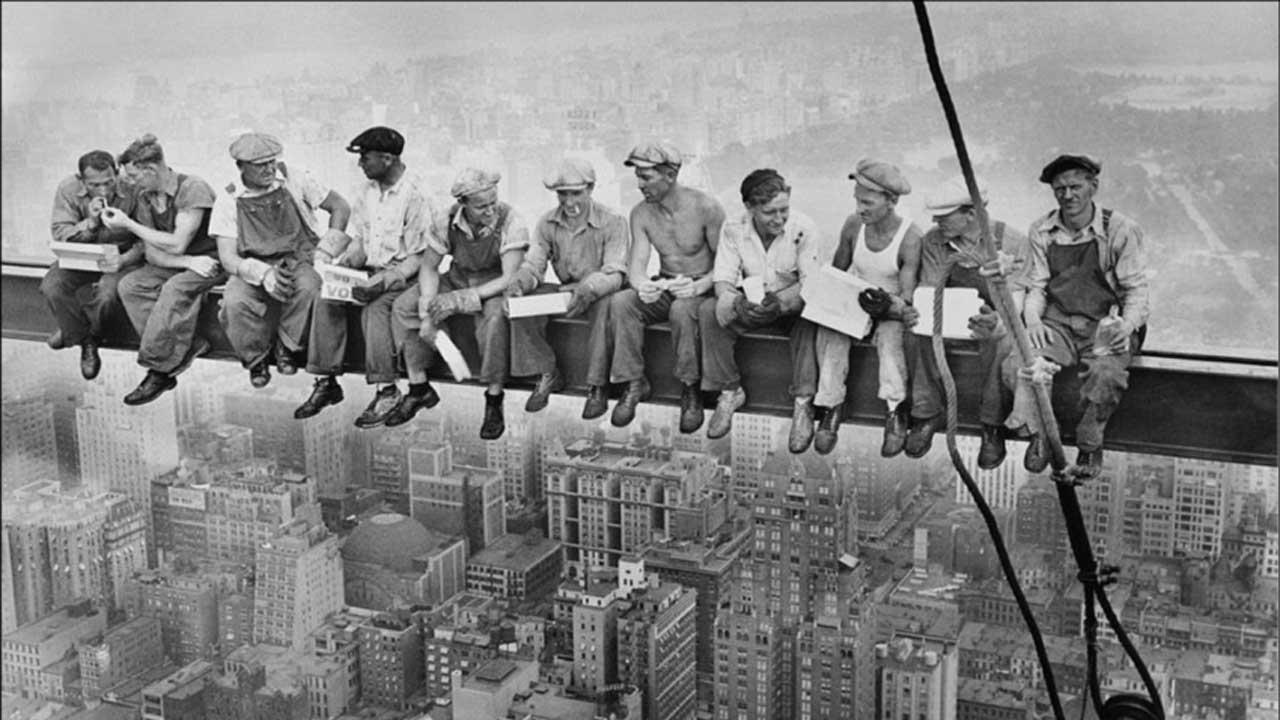 ironworkers having lunch atop a skyscraper