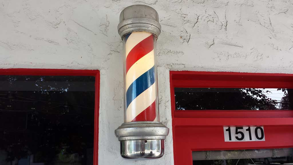 red and white barber shop pole