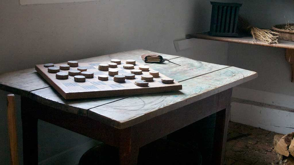 checkers board on an old table