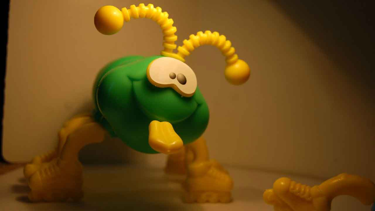green cootie toy